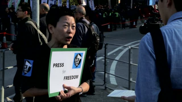 stockvideo's en b-roll-footage met protestors take to hong kong streets to march for press freedom, in a demonstration organised by journalists as fears grow that free expression is... - hong kong