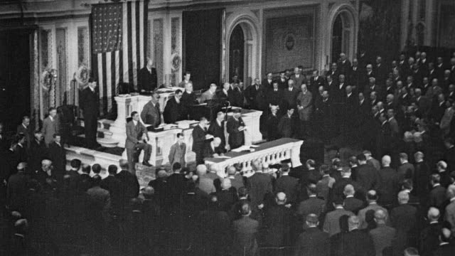 protestors walking through the streets of washington dc / interior shot of new congress being sworn in new congress sworn in that favors the jobless... - 1930 stock-videos und b-roll-filmmaterial