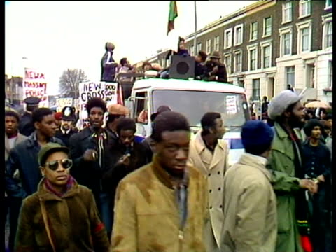 protestors with placards and banners march against police handling of fire in new cross which killed thirteen black youths london mar 81 - rescue services occupation stock videos & royalty-free footage
