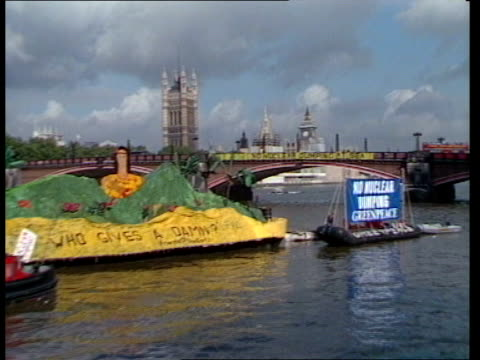 protests against dumping of nuclear waste at sea itn london westminster bridge 'no nuclear dumping' banner on it pull out demonstration crafts on... - demonstrant stock-videos und b-roll-filmmaterial