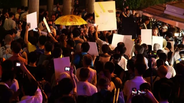 vídeos de stock, filmes e b-roll de protests as hong kong marks 20th anniversary of handover to china hong kong protesters marching along and chanting sot various shots of protesters... - livraria