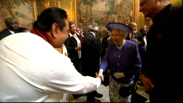 protests as sri lankan president attends diamond jubilee lunch int rajapaksa shaking hands inside building queen elizabeth ii shaking hands with... - british empire stock videos & royalty-free footage
