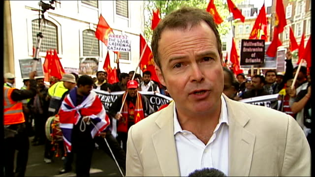 protests as sri lankan president attends diamond jubilee lunch england london various of protesters marching along reporter to camera wide shot big... - sri lankan flag stock videos & royalty-free footage