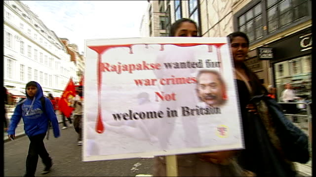 vídeos y material grabado en eventos de stock de protests as sri lankan president attends diamond jubilee lunch england london pall mall ext protesters towards holding 'rajapakse wanted for war... - placard