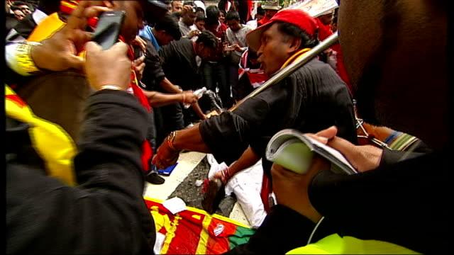 protests as sri lankan president attends diamond jubilee lunch england london pall mall ext demonstrators surrounding effigy of sri lankan president... - sri lankan flag stock videos & royalty-free footage