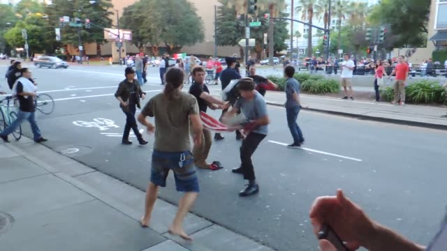 protests at a san jose trump rally - fight stock videos and b-roll footage