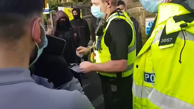 protests at batley grammar school after cartoons of the prophet mohammed shown to pupils; england: west yorkshire: batley: ext various of people... - education stock videos & royalty-free footage