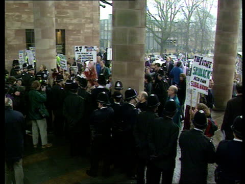 protests at coventry cathedral celebration of the car england ms 1897 daimler towards into cathedral coventry lms side car up aisle pan lr cathedral... - cattedrale video stock e b–roll
