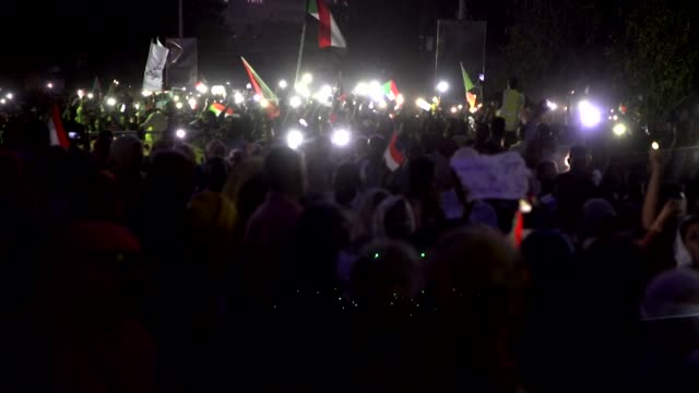 protests at night in khartoum with protesters wanting a civilian government after president omar albashir was forced from power - スーダン点の映像素材/bロール