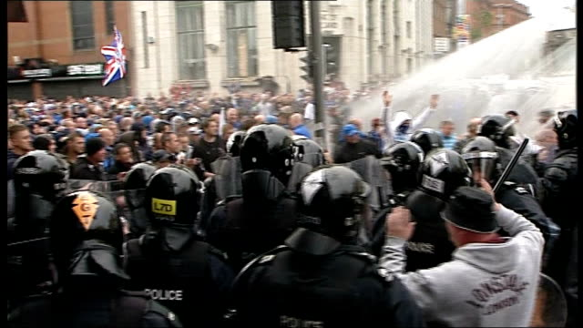 protests at republican parade in belfast; northern ireland: belfast: ext police clashing with loyalist supporters ahead of republican parade, as... - water cannon stock videos & royalty-free footage