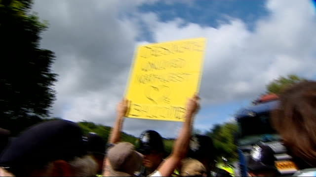 protests continue at balcombe fracking site: cuadrilla chief executive interview; england: west sussex: balcombe: ext police officers moving group of... - protesta anti fracking video stock e b–roll