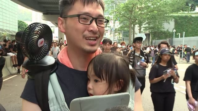 protests continue despite suspension of extradition bill china hong kong ext protesters passing chinese communist party building vox pops sot large... - chinese communist party stock videos and b-roll footage
