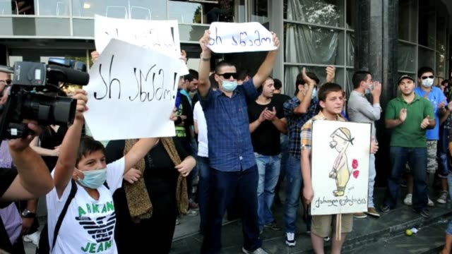 protests continue friday in georgias capital tbilisi following release of videos this week showing torture voiced : protests about prison on... - georgia bildbanksvideor och videomaterial från bakom kulisserna
