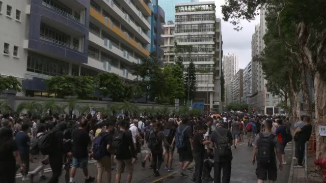 protests continue in hong kong / china releases video of troops training on border; hong kong; various shots of protesters along holding umbrellas,... - civilian stock videos & royalty-free footage