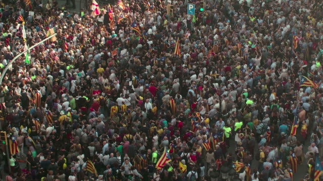 protests in barcelona against suspension of catalan autonomy by madrid government - government stock videos and b-roll footage