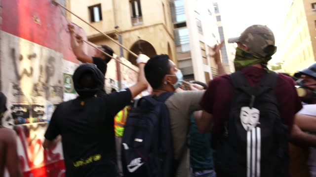protests on streets of beirut after massive explosion at the port area sparked anger towards the lebanese government over their handling of the crisis - protestor stock videos & royalty-free footage