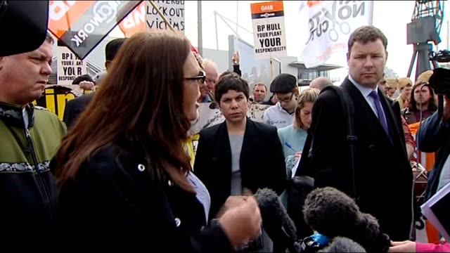 protests outside bp annual general meeting; ext tracy kuhns addressing others outside meeting sot - annual general meeting stock videos & royalty-free footage