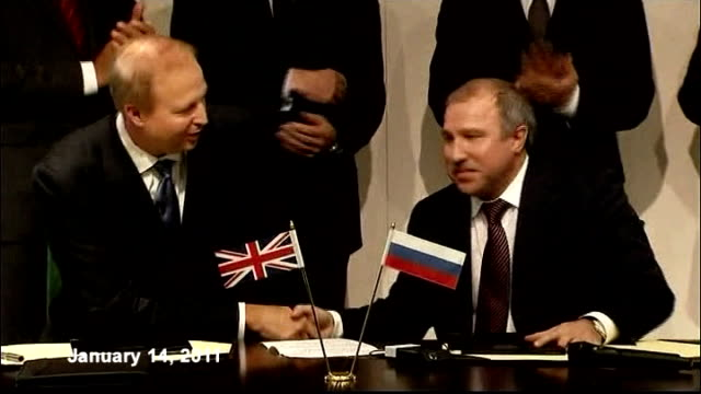 protests outside bp annual general meeting lib photography *** bp chief executive bob dudley and rosneft chief executive eduard khudainatov signing... - annual general meeting stock videos & royalty-free footage