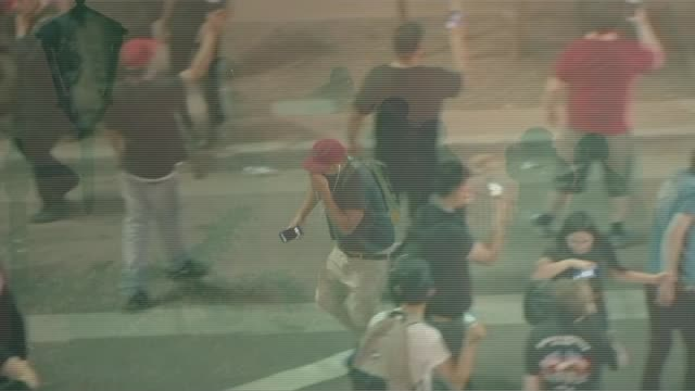 protests outside phoenix rally as trump attacks the media; usa: arizona: phoenix: ext at night various of riot police officers policing anti-trump... - tear gas stock videos & royalty-free footage
