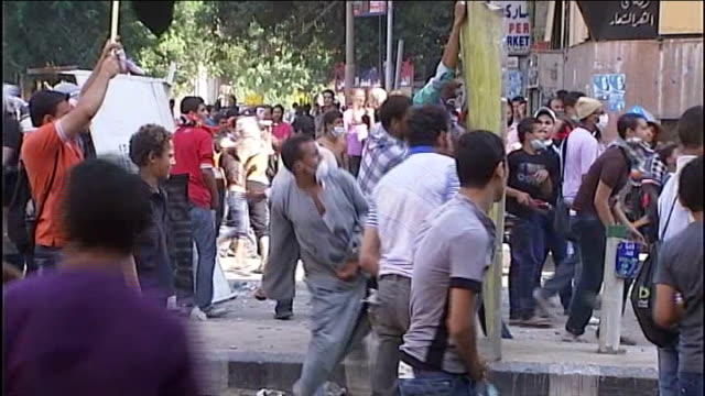 protests over anti islamic film spread across north africa egypt cairo ext high angle view of police firing water cannon towards protesters on top of... - demonstration stock videos & royalty-free footage