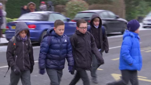 Protests over council Uturn on new Free School in Bromley ENGLAND London Bromley Boys along pavement Schoolboys crossing road **Vox pop partly...