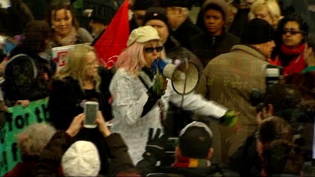 vídeos y material grabado en eventos de stock de london trafalgar square ext **voice heard through megaphone sot** high angle view protesters pan woman speaking into megaphone next to 'axe bedroom... - placard