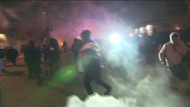 protests, police clash in ferguson on night of michael brown jury decision on november 27, 2014 in ferguson, missouri. - tear gas stock videos & royalty-free footage