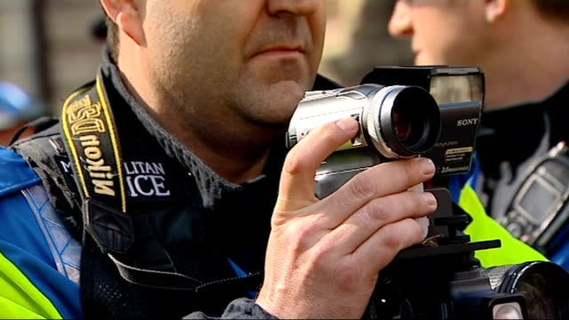 review of policing tactics ordered; 1.4.2009 metropolitan police officer filming protests with digital camcorder officer holding camera - digital camcorder stock videos & royalty-free footage