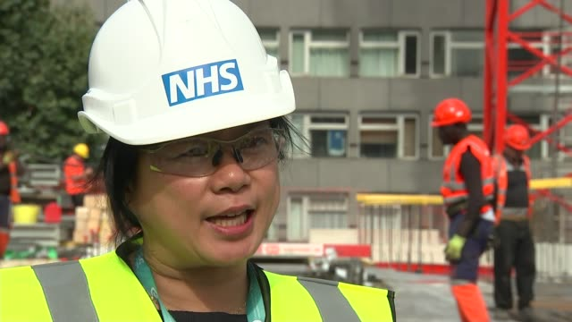Proton beam cancer therapy to be available on NHS UK London University College Hospital Crane lowering proton centre doctor director and construction...