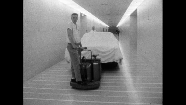 prototype car is transported through gm technical centre; 1964 - only mid adult men stock videos & royalty-free footage