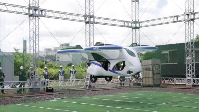 a prototype of nec corp's flying car floats in the air during a demonstration at a testing site of the company's plant in abiko chiba prefecture... - futuristic stock videos & royalty-free footage