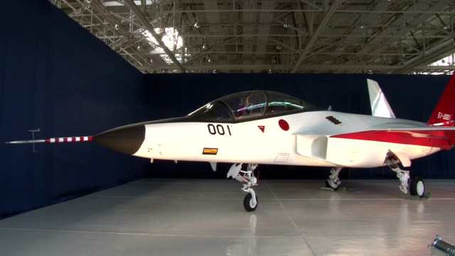 a prototype of the first japanmade stealth fighter was unveiled to the media thursday at a mitsubishi heavy industries ltd factory in central japan... - prototype stock videos & royalty-free footage
