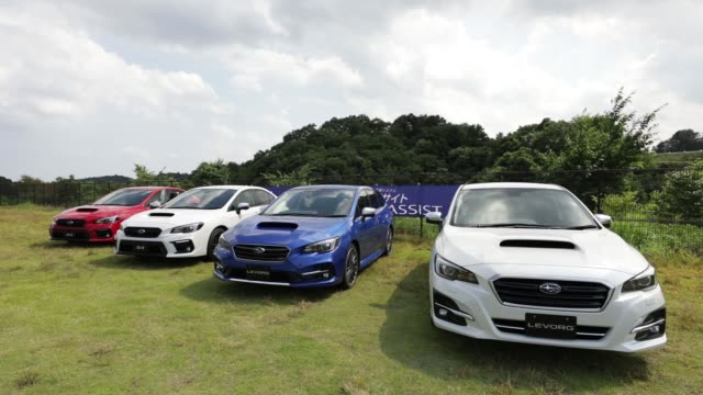 Prototype Subaru Corp WRX S4 sedans left and prototype Levorg vehicles both equipped with the company's EyeSight driving support system stand on...