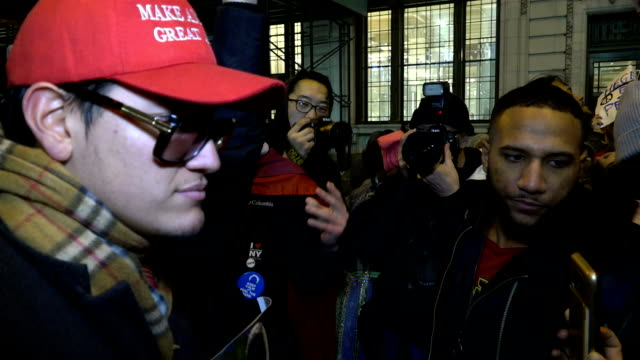 ProTrump protester argues in Spanish with Anti Donald Trump protesters / The rally began in Foley Square and marched to Wall Street Broad Street in...