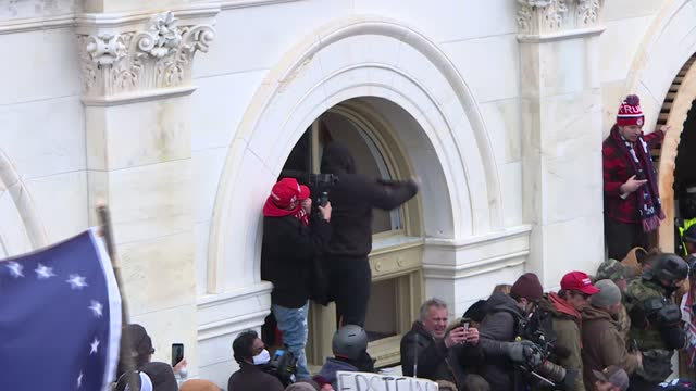 vídeos de stock e filmes b-roll de pro-trump rioters stormed the us capitol wednesday as lawmakers were set to sign off on president-elect joe biden's electoral victory in what was... - capitólio capitol hill