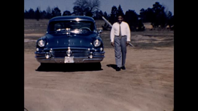1957 proud african-american man with new buick - home movie stock videos & royalty-free footage
