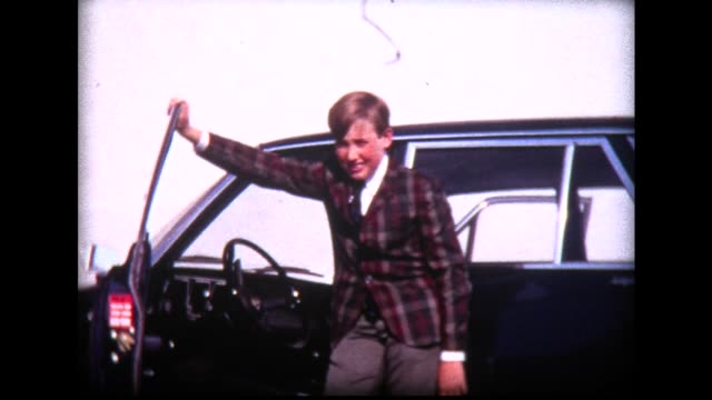 1965 proud boy by car with girls heckling him - teasing stock videos & royalty-free footage