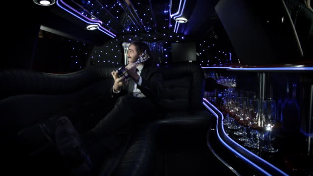 proud celebrity in back of limousine shows off awards trophy to paparazzi at awards show - glamour stock videos & royalty-free footage