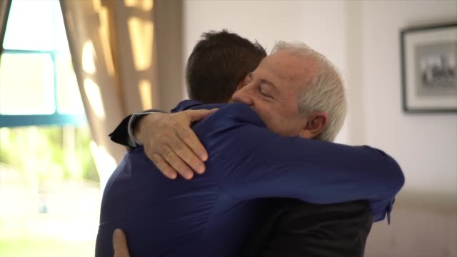 proud father embracing his son and groom before weeding - son stock videos & royalty-free footage