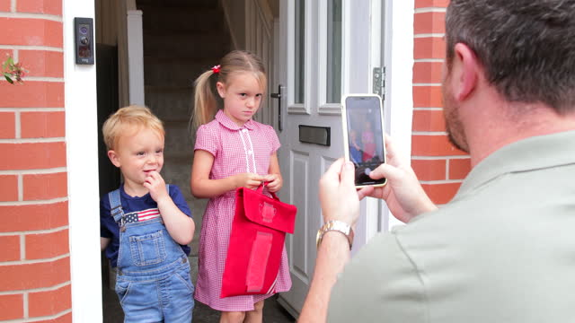 proud father on first day of school - satchel stock videos & royalty-free footage
