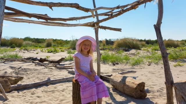MS proud girl sitting in self-made beach hut