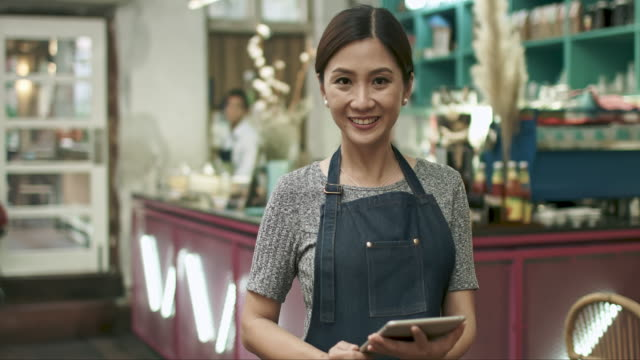 proud malay chinese businesswoman at her coffee shop - cultura malesiana video stock e b–roll