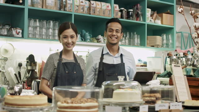 proud malay couple coffee shop owners - cultura malesiana video stock e b–roll