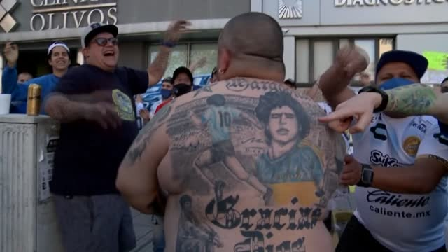 """proud maradona fan shows off his body covered in tribute tattoos as the football legend's personal doctor assures the patient is """"doing very well""""... - buenos aires province stock videos & royalty-free footage"""