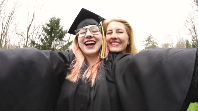 proud mom taking selfies with graduate daughter - daughter stock videos & royalty-free footage