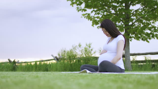 proud mom-to-be - woman cross legged stock videos & royalty-free footage