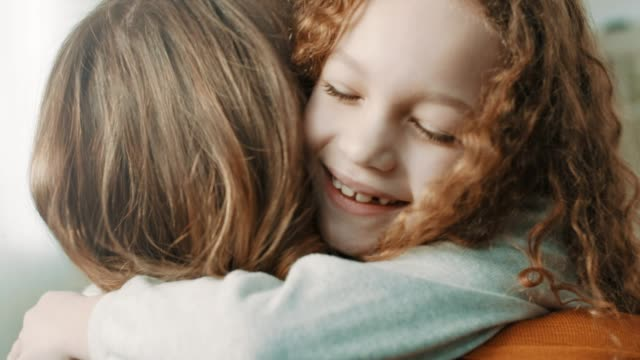 proud mother hugging daughter - family with one child stock videos & royalty-free footage