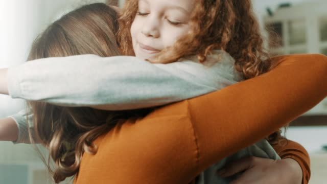 proud mother hugging daughter - stringere tenere video stock e b–roll