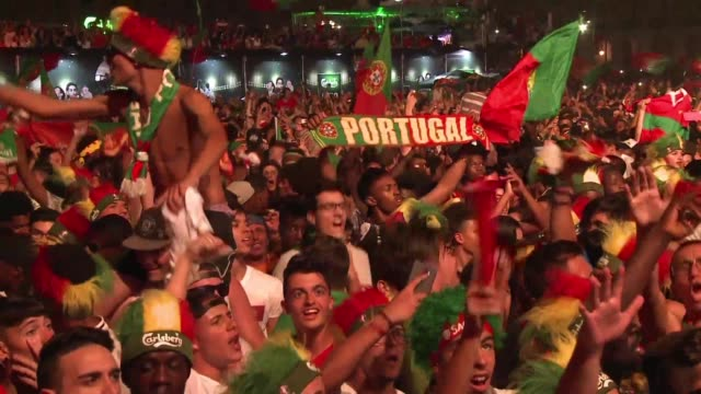 vídeos de stock, filmes e b-roll de proud portugal fans celebrate their side finally being crowned european champions after their 10 victory over france - euro 2016