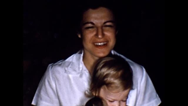 vidéos et rushes de 1956 proud young mother with daughter - bébés filles